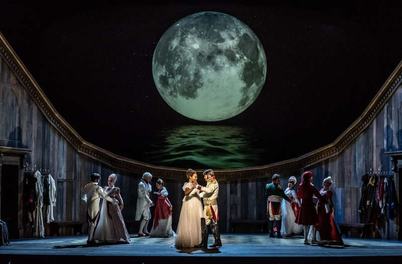 Natasha and Andrei dance together, as do four other couples, under the moon.