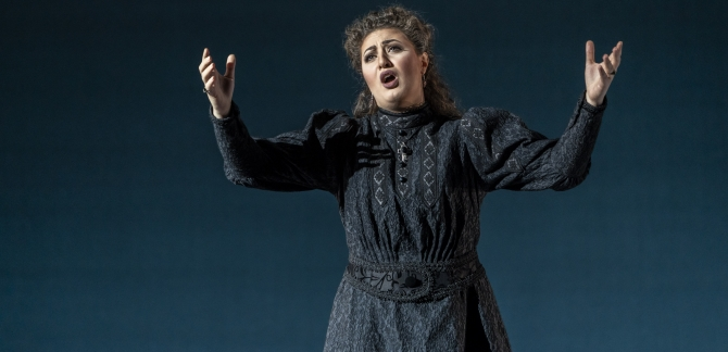 Woman singing with arms outstretched