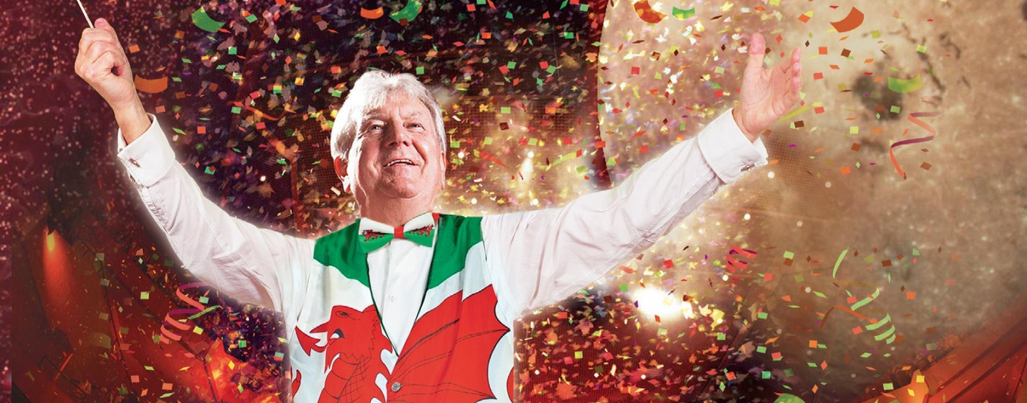 Poster shows a male conductor dresses in a red, white and green waistcoat, with planets, balloons and Welsh flags.