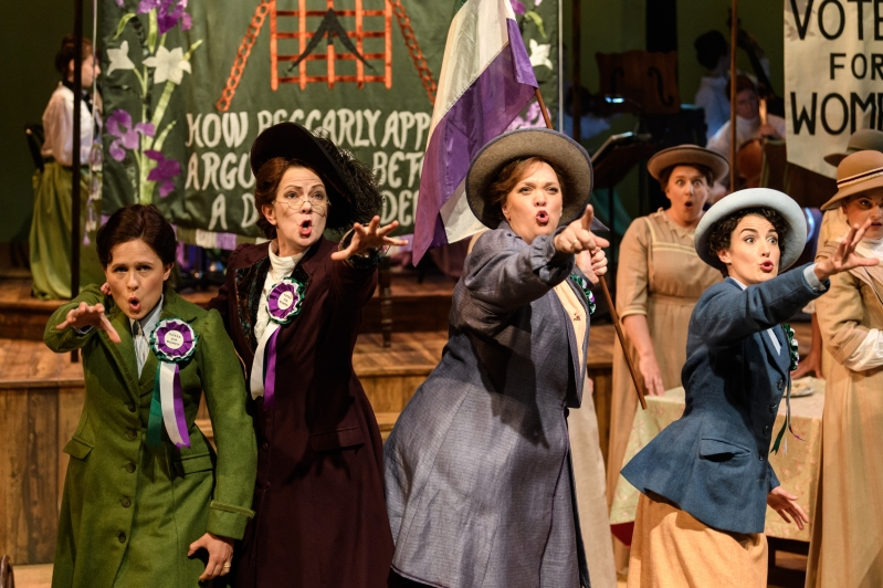 Rhondda and friends appear passionate, reaching out and pointing to the audience.