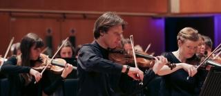 WNO Orchestra violinists.