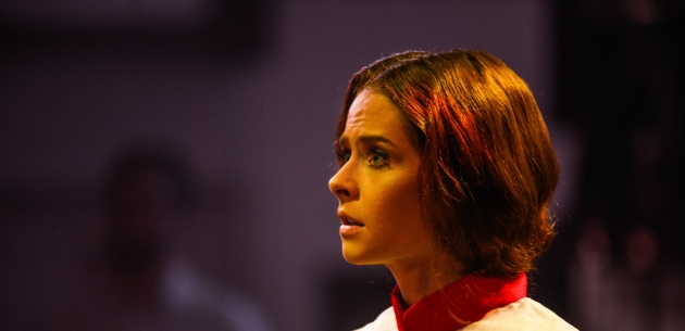 Close-up profile of a young woman on stage.