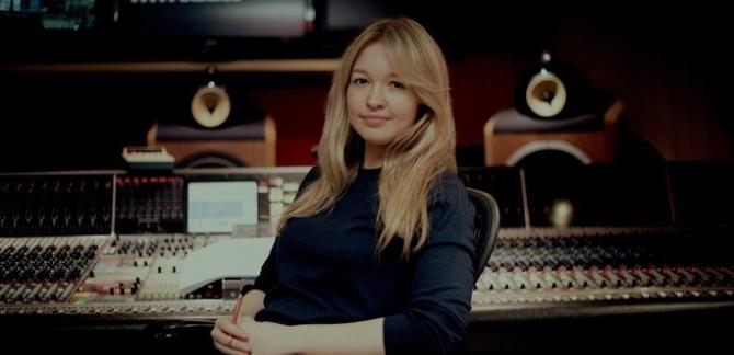 Rebecca Dale sits in front a sound desk