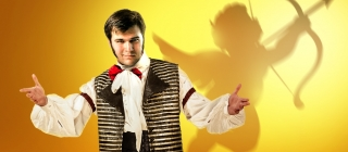 A young man holds out his arms. The silhouette of a cherub shows on the yellow background.