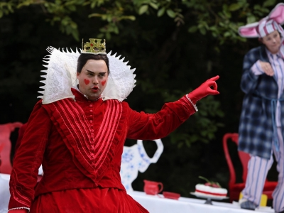Queen of Hearts stood and pointing firmly