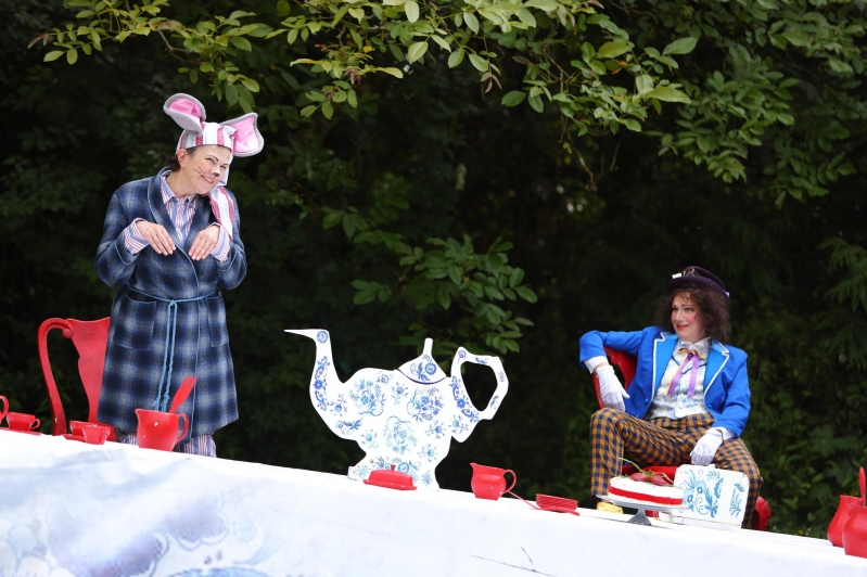 Dormouse and Mad Hatter are either side of the teapot